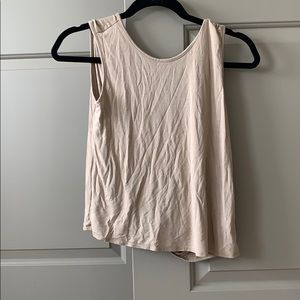 Tan shirt with twist in back